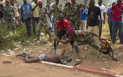 Soldier pictured stabbing man to death in front of a crowd