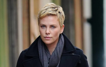 Charlize Theron says she is 'very happy' with Sean Penn