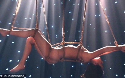 Dakota Johnson: stripped and suspended in new music video, Fifty Shades of Grey