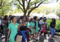 Black school girls protest after being told to straighten their hair